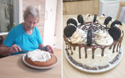 Resident decorating a birthday cake at Lulworth House Care Home