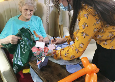Lulworth House Residential Care Home resident opening some birthday gifts
