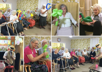 Lulworth House Residential Care Home residents watching Punch and Judy show entertainment